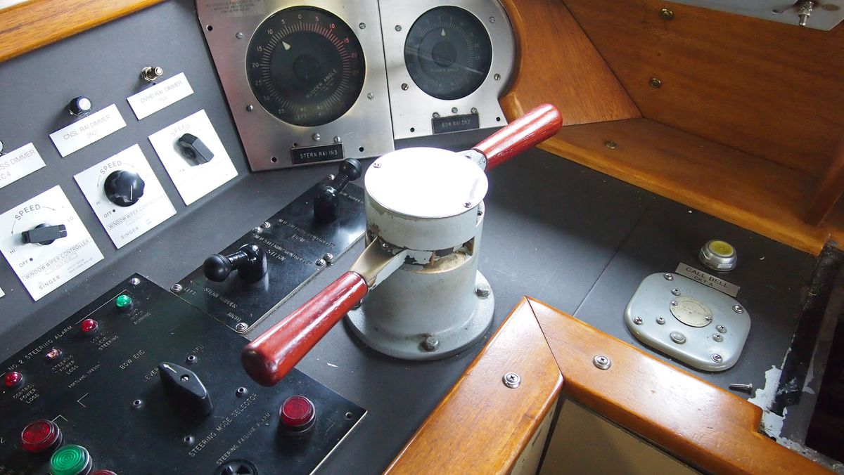 Controls and gauges at the helm of a ferry