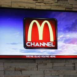 In this photo taken Friday, Sept. 7, 2012, the new McDonald's television channel is seen at a McDonald's restaurant in Norwalk, Calif. McDonald's is testing its own TV channel in 700 California restaurants in a pilot project that could expand to all the company's restaurants.