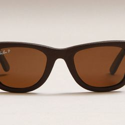 """<b>Concepts x Ray-Ban</b> Polarized Leather Wayfarer, <a href=""""http://shop.cncpts.com/products/ray-ban-wayfarer-polarized-leather-brown"""">$300</a>"""
