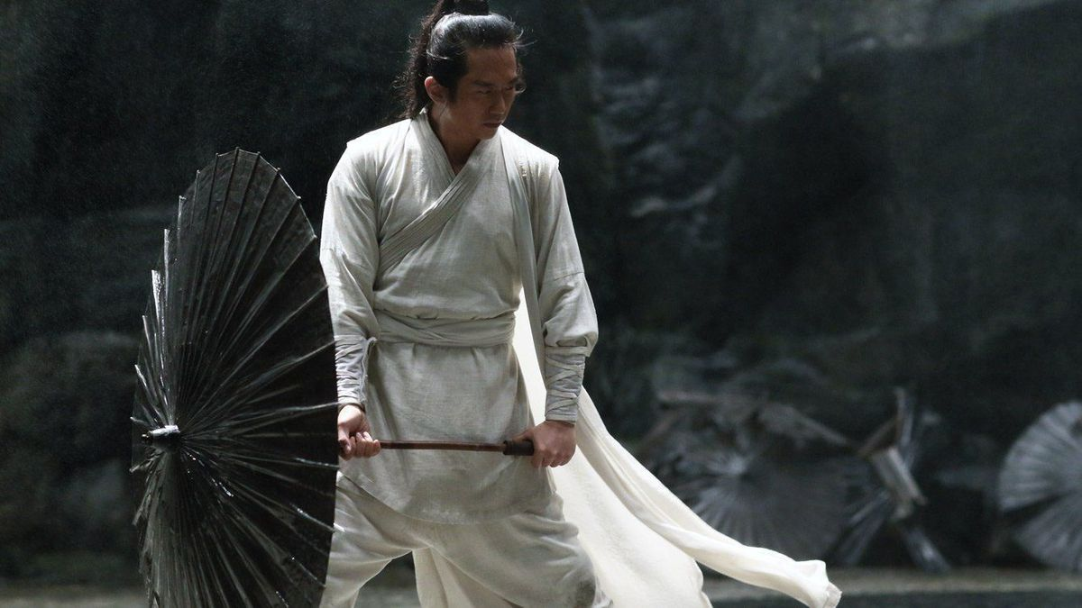 shadow: a man in a flowing white robe twirls a deadly black umbrella in the underground caven under a palace