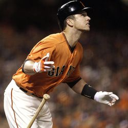 San Francisco Giants' Buster Posey watches his RBI double off San Diego Padres' Cory Luebke in the fifth inning of a baseball game, Friday, April 27, 2012, in San Francisco.