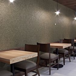 Pebble-looking cork and formica wallpaper changes color as light hits it from different angles