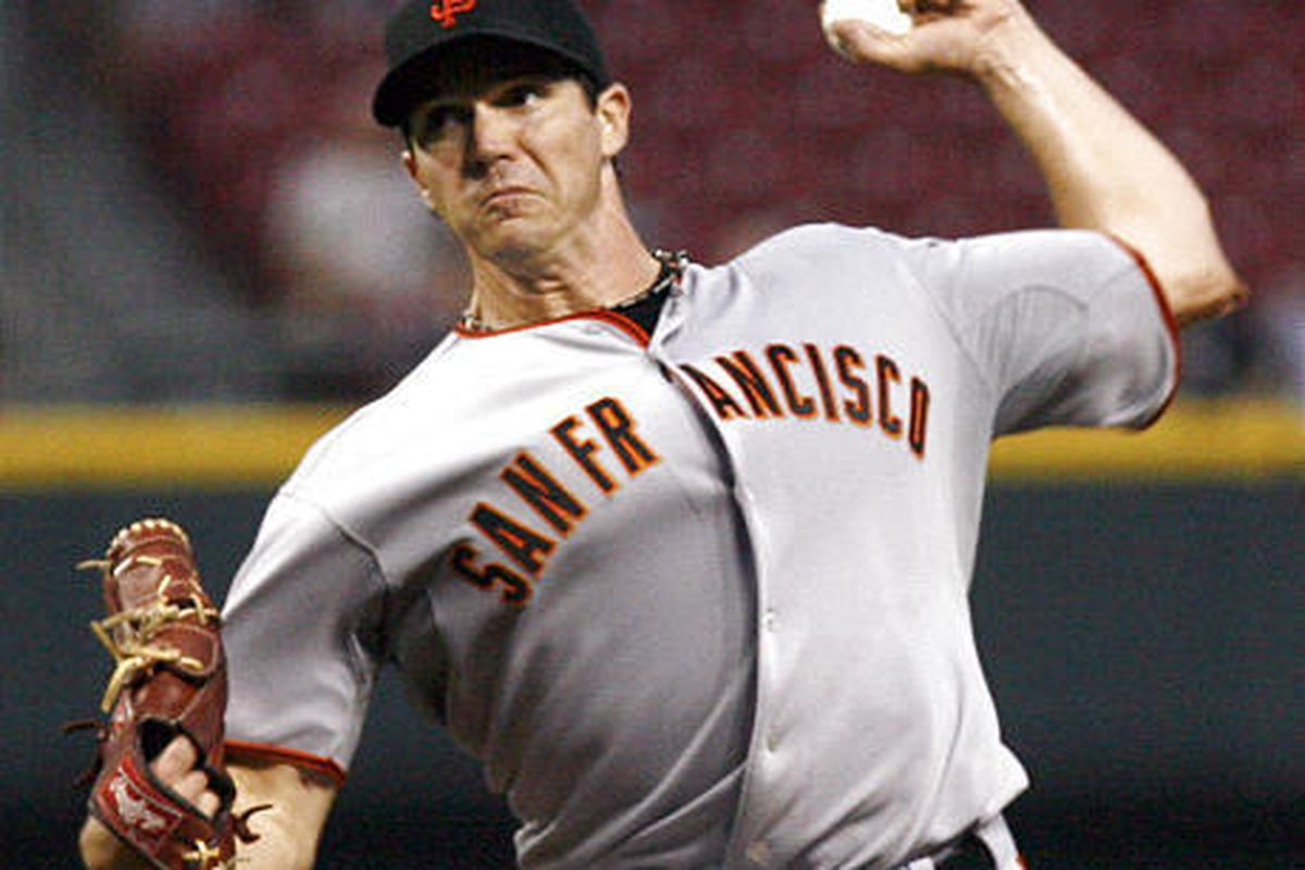 Barry Zito throws against the Cincinnati Reds, giving up two hits over the first six innings.