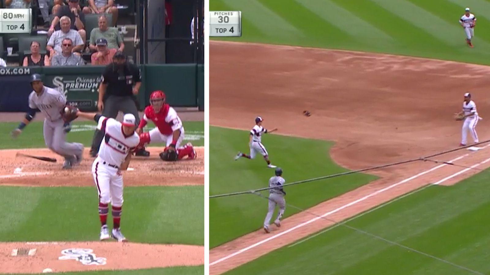 白袜队投手让背后的接球,首先将手套投入,因为球被卡住了