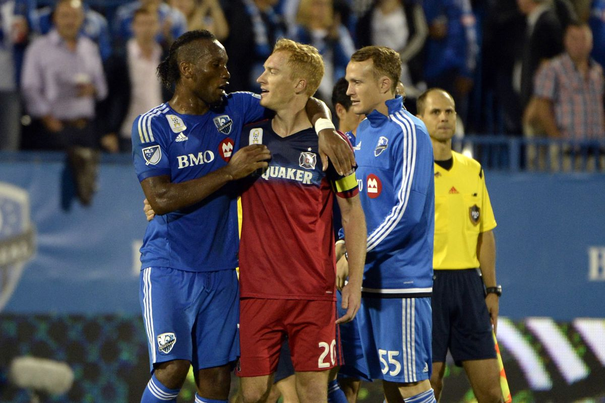 Didier Drogba talks to Chicago Fire's Jeff Larentowicz after the game on September 23rd, 2015.