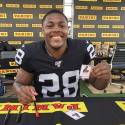 Josh Jacobs shows off his football cards