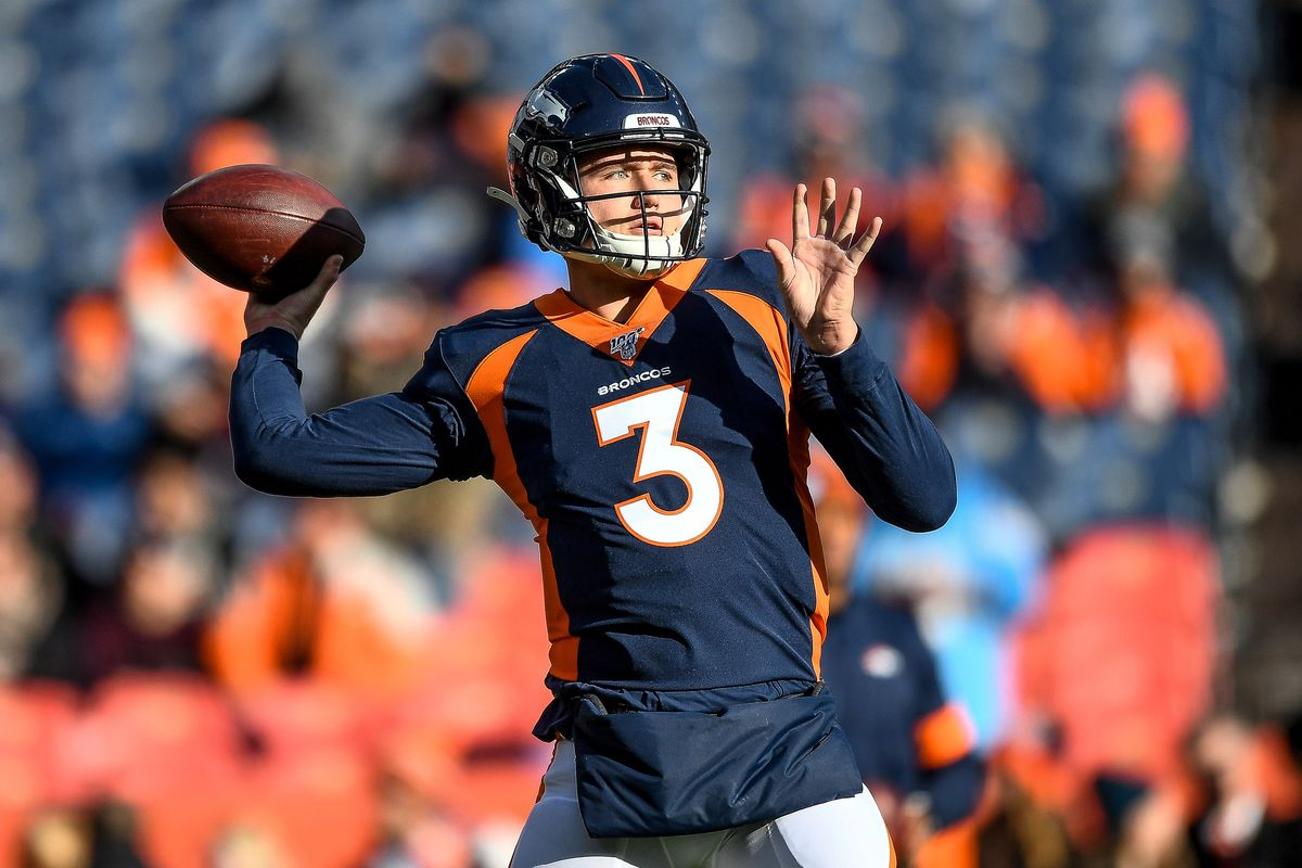 Drew Lock of the Denver Broncos throws a pass as he warms up before a game against the Los Angeles Chargers at Empower Field at Mile High on December 1, 2019 in Denver, Colorado.
