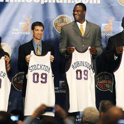 FILE  This is an April 6, 2009, file photo showing, from left, Rutgers women's coach C. Vivian Stringer, and former NBA basketball players John Stockton, David Robinson and Michael Jordan, holding jerseys, in Detroit, at the announcement that they were elected to the Basketball Hall of Fame. Utah Jazz coach Jerry Sloan, not shown, was also part of the 2009 class.