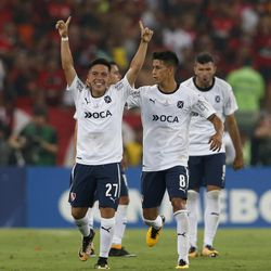 Argentina's Independiente Ezequiel Barco, left, is congratulated by teammate Maximiliano Meza after scoring from the penalty spot against Brazil's Flamengo during the Copa Sudamericana final championship soccer match at Maracana stadium in Rio de Janeiro, Brazil, Wednesday, Dec.13, 2017.