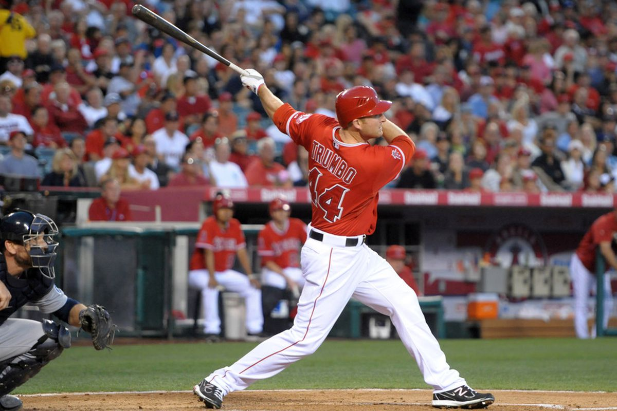 Jun 5, 2012; Anaheim, CA, USA; Los Angeles Angels left fielder Mark Trumbo (44) follows through on a two-run home run against the Seattle Mariners at Angel Stadium. Mandatory Credit: Kirby Lee/Image of Sport-US PRESSWIRE