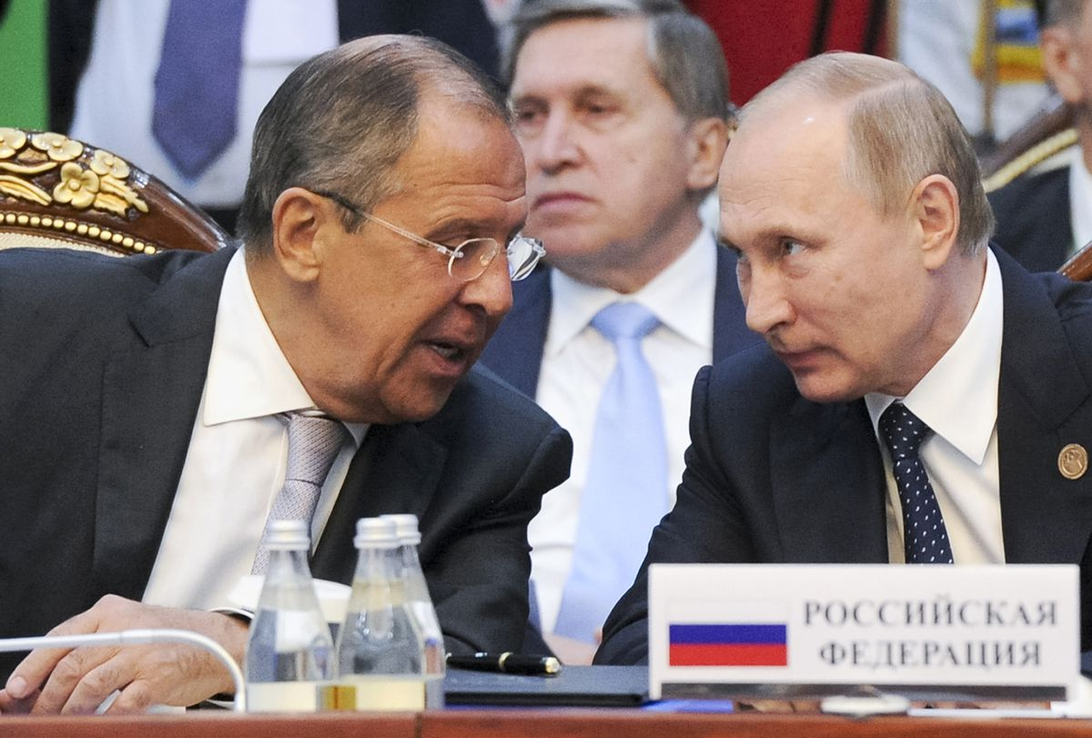 Russian President Vladimir Putin, right, and Russian Foreign Minister Sergey Lavrov speak each other at a CIS (Commonwealth of Independent States, former Soviet republics) summit in Bishkek, Kyrgyzstan, Saturday. | Sputnik, Kremlin pool photo via AP