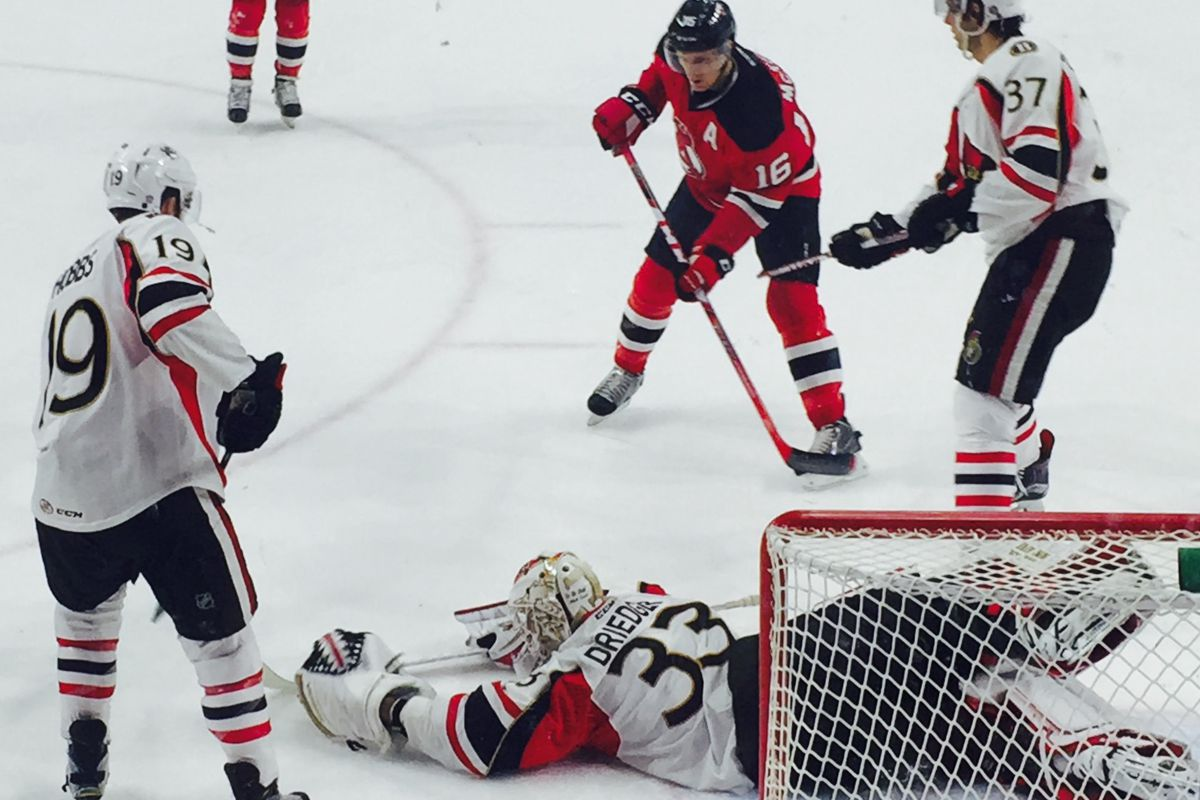 BSens goaltender Chris Driedger covers up in Friday's 3-2 OT loss to the Albany Devils