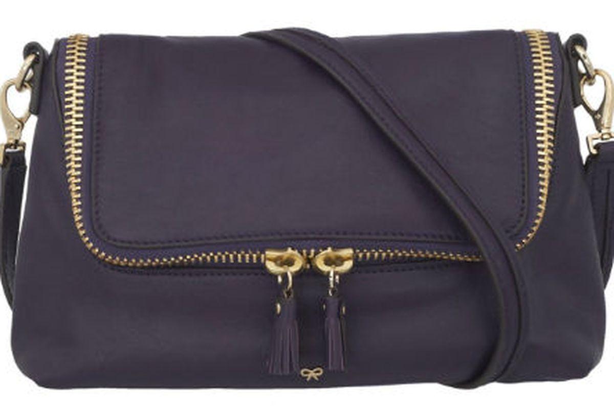 "The Maxi Zip Cross Body in <a href=""http://www.anyahindmarch.com/prod/Handsfree/Handbags/Maxi_Zip_Cross_Body/44127/"">dark plum</a>"