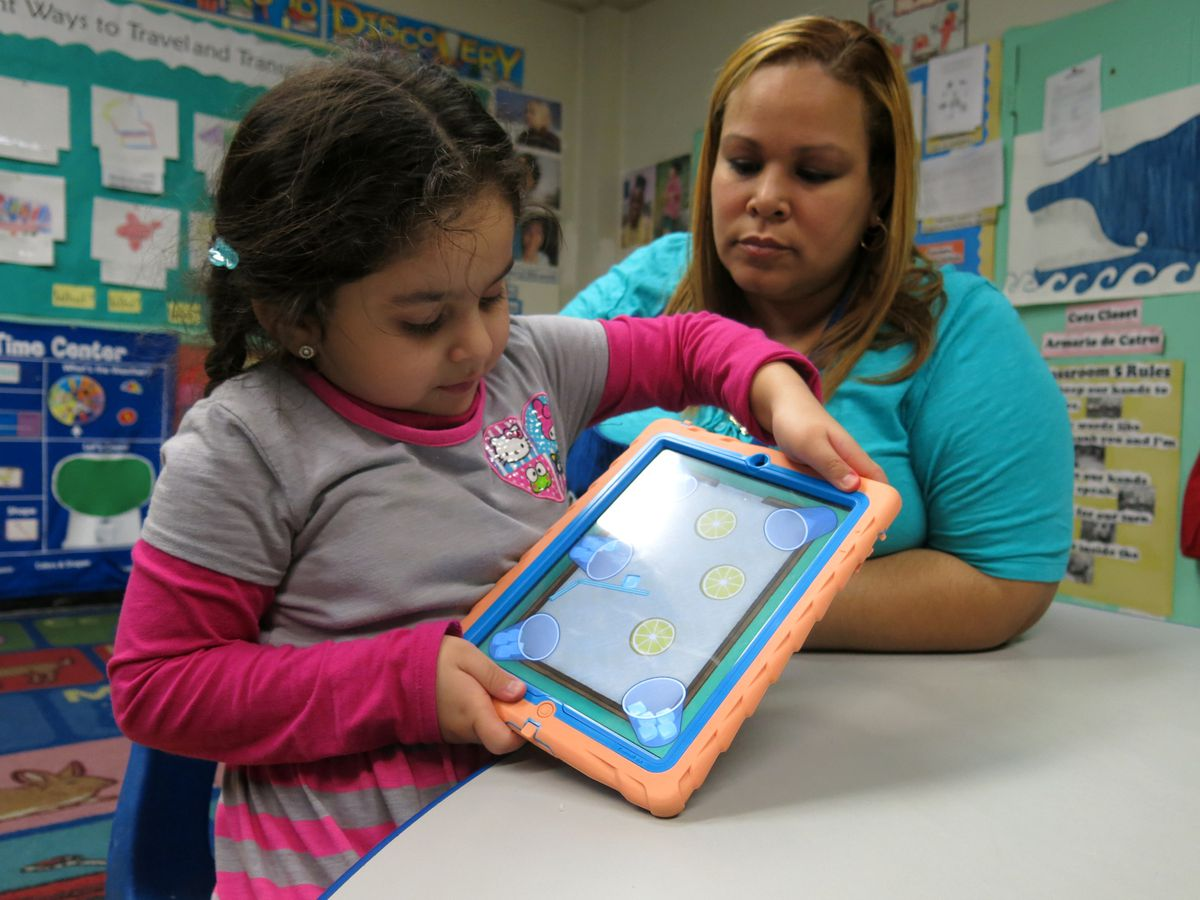 A teaching assistant worked with a pre-K student in East Harlem in 2014.