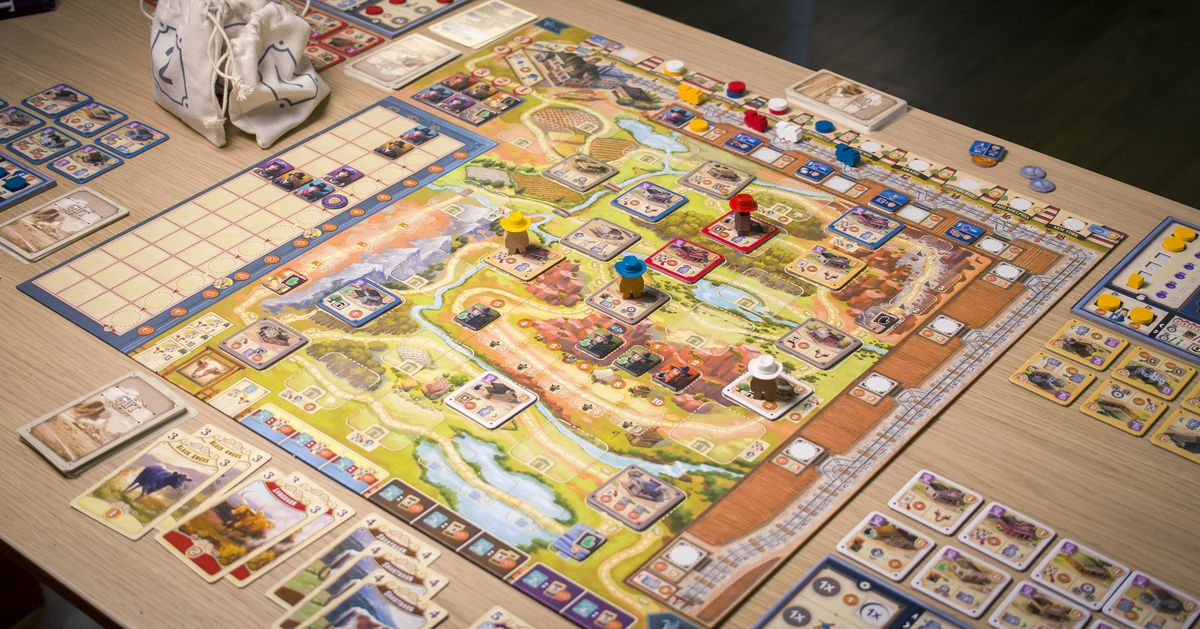 The full layout for Great Western Trail: Second Edition includes cloth bags, tiles, and plenty of tiny little trains.