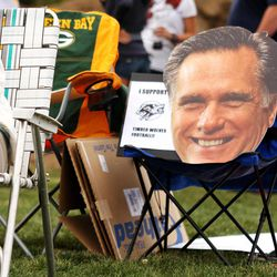 A large Mitt Romney card board head takes a seat in a lawn chair during the Living Word Lutheran versus Random Lake high school football game in Jackson, Wis., Saturday, Sept. 1, 2012. Living Word lost 25-12.