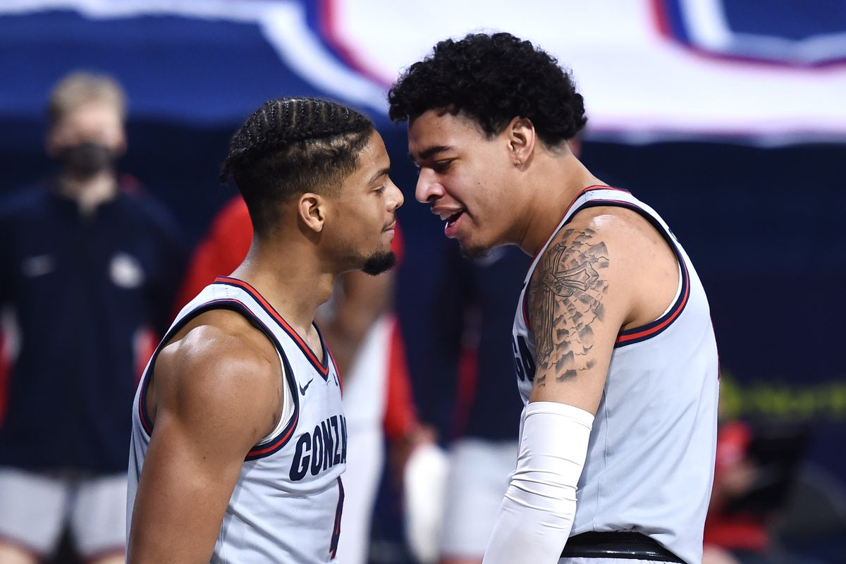 Gonzaga Bulldogs guard Aaron Cook and Gonzaga Bulldogs guard Julian Strawther celebrate a basket and foul against San Diego Toreros in the second half at McCarthey Athletic Center.