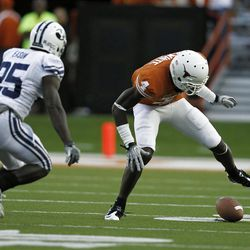 Wide receiver Darius White #4 of the Texas Longhorns fumbles a second quarter pass as defensive back Corby Eason #25 of the BYU Cougars comes in to tackle on September 10, 2011 at Darrell K. Royal-Texas Memorial Stadium in Austin, Texas.  White recovered his own fumble. (Photo by Erich Schlegel/Getty Images)