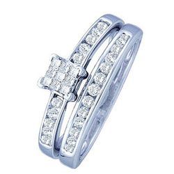 """Talk about a two-for-one deal: This style doubles as both engagement and wedding band for an insanely good sale price. $799, <a href=""""ww.adamsjewelry.com/Engagement-Rings,category,1,catalog-products.html#!prettyPhoto/3/"""">Adam's Jewelry</a>"""