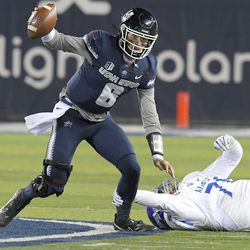 Utah State quarterback Andrew Peasley (6) scrambles away from Air Force defensive tackle George Silvanic (78) during the first half of an NCAA college football game Thursday, Dec. 3, 2020, in Logan, Utah.