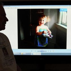 In this March 27, 2012 photo, Jeff Hanson displays a photo on his website about his missing step-granddaughter at his home in Portland, Maine. Hanson decided he needed to do something constructive as the investigation drew out, so he created the first of two websites aimed at drawing attention to Ayla Reynolds, the Maine toddler who disappeared on the night of Dec. 16 from her father's home in Waterville. The original website has received more than 1 million clicks, and there are now more than a dozen websites, blogs and Facebook pages dedicated to the case of the blond, blue-eyed youngster, helping to raise awareness along with billboards, posters and other conventional means of spreading the word about missing children.