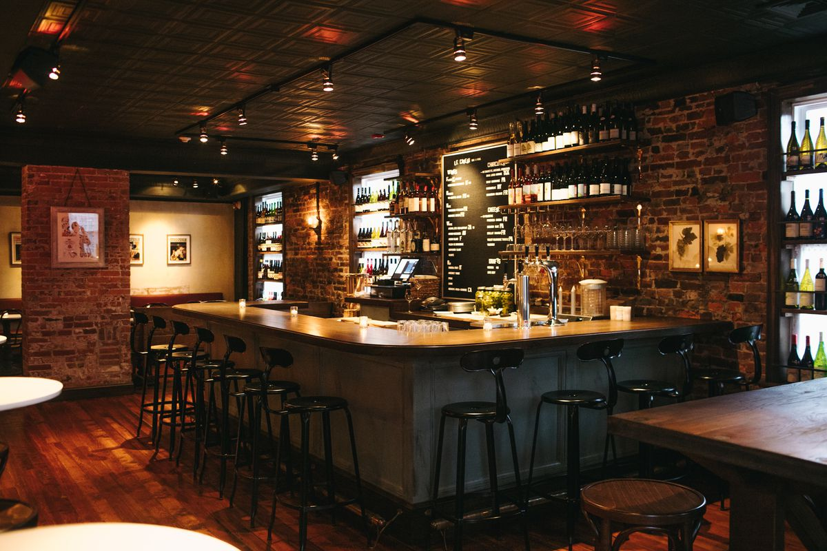dimly lit bar with exposed brick walls