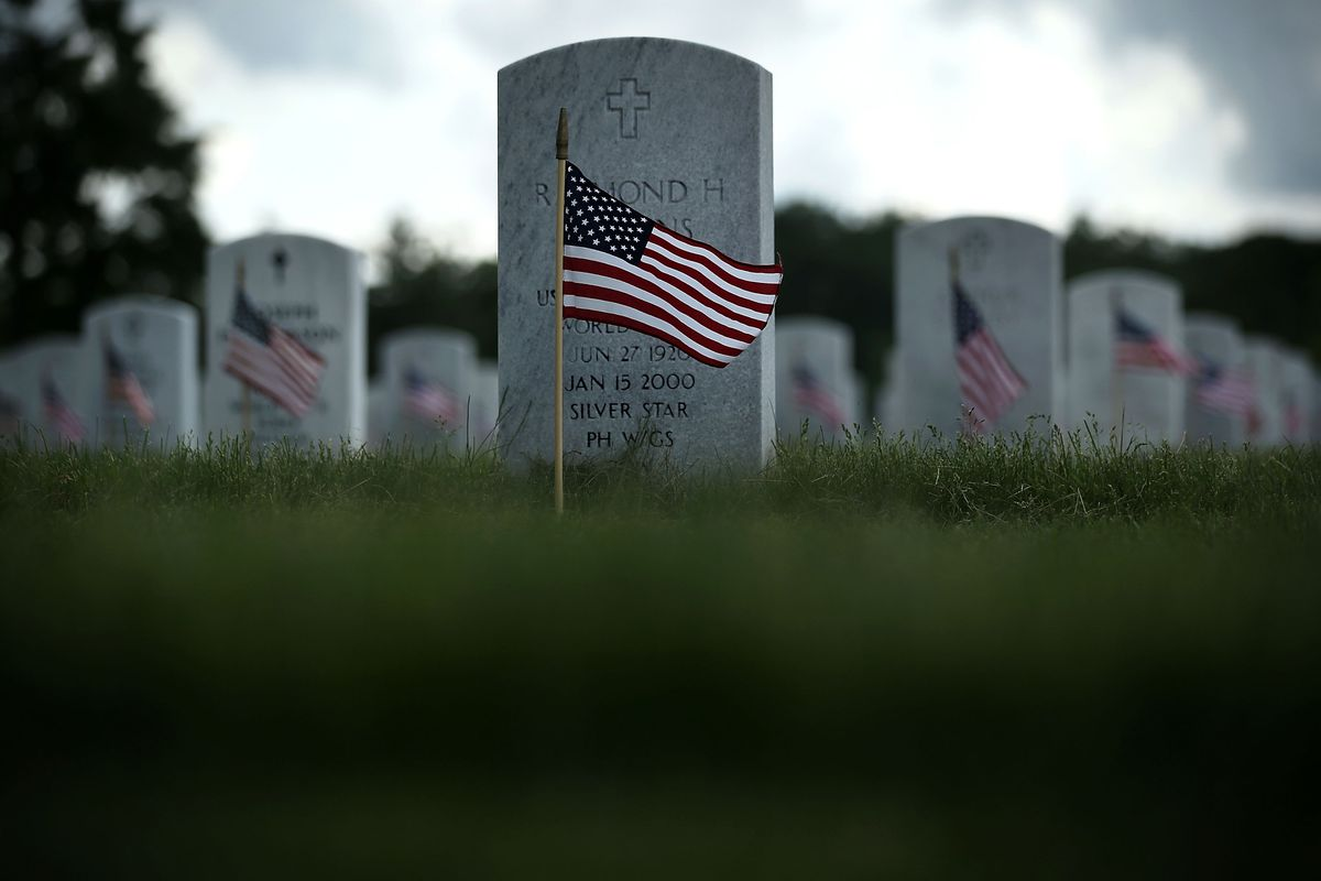 Arlington National Cemetery Holds 'Flags In' Ceremony Ahead Of Memorial Day