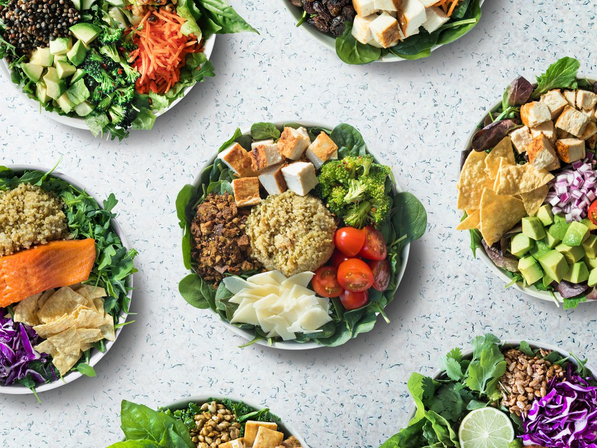 A variety of salad bowls featuring different ingredients