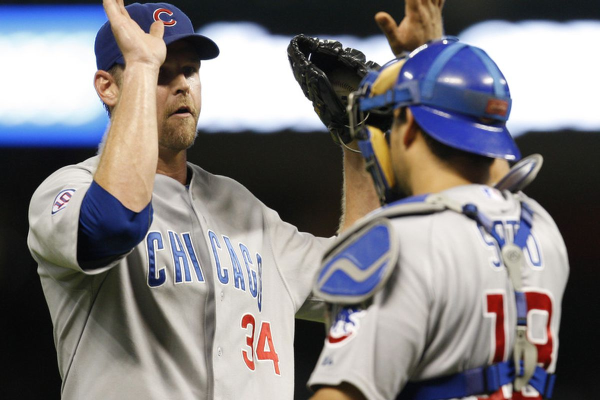 Pitcher Kerry Wood of the Chicago Cubs celebrates with catcher Geovany Soto their 4-3 victory over the Houston Astros at Minute Maid Park in Houston, Texas. (Photo by Eric Christian Smith/Getty Images)