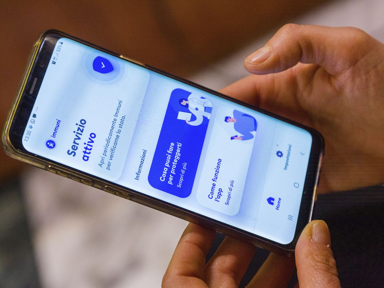 Italian Technological Innovation and Digitalization Minister, Paola Pisano shows her phone, featuring a contact tracing app that Italy launched nationwide in its efforts to contain COVID-19's spread, during an interview with The Associated Press in Rome, Thursday, June 11, 2020.