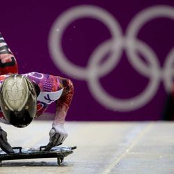 Eric Neilson of Canada starts his first run during the men's skeleton competition at the 2014 Winter Olympics, Friday, Feb. 14, 2014, in Krasnaya Polyana, Russia. He was 12th after the first two heats Friday.