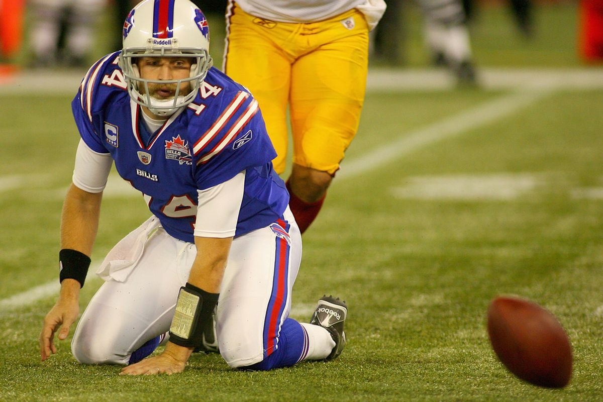 TORONTO, ON - OCTOBER 30: Ryan Fitzpatrick #14 of the Buffalo Bills fumbles in the first half against the Washington Redskins at Rogers Centre on October 30, 2011 in Toronto, Ontario.  (Photo by Rick Stewart/Getty Images)