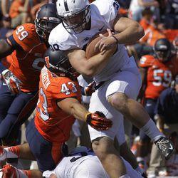 Penn State running back Zach Zwinak (28) runs through Illinois linebacker Mason Monheim (43) during the second half of an NCAA college football game Saturday, Sept. 29, 2012, in Champaign, Ill. Penn State defeated Illinois 35-7.