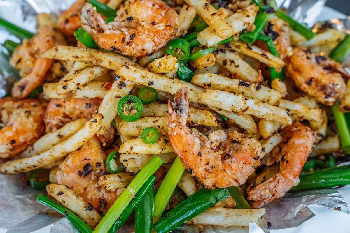 A deep-fried shrimp dish with green vegetables at Chengdu Taste