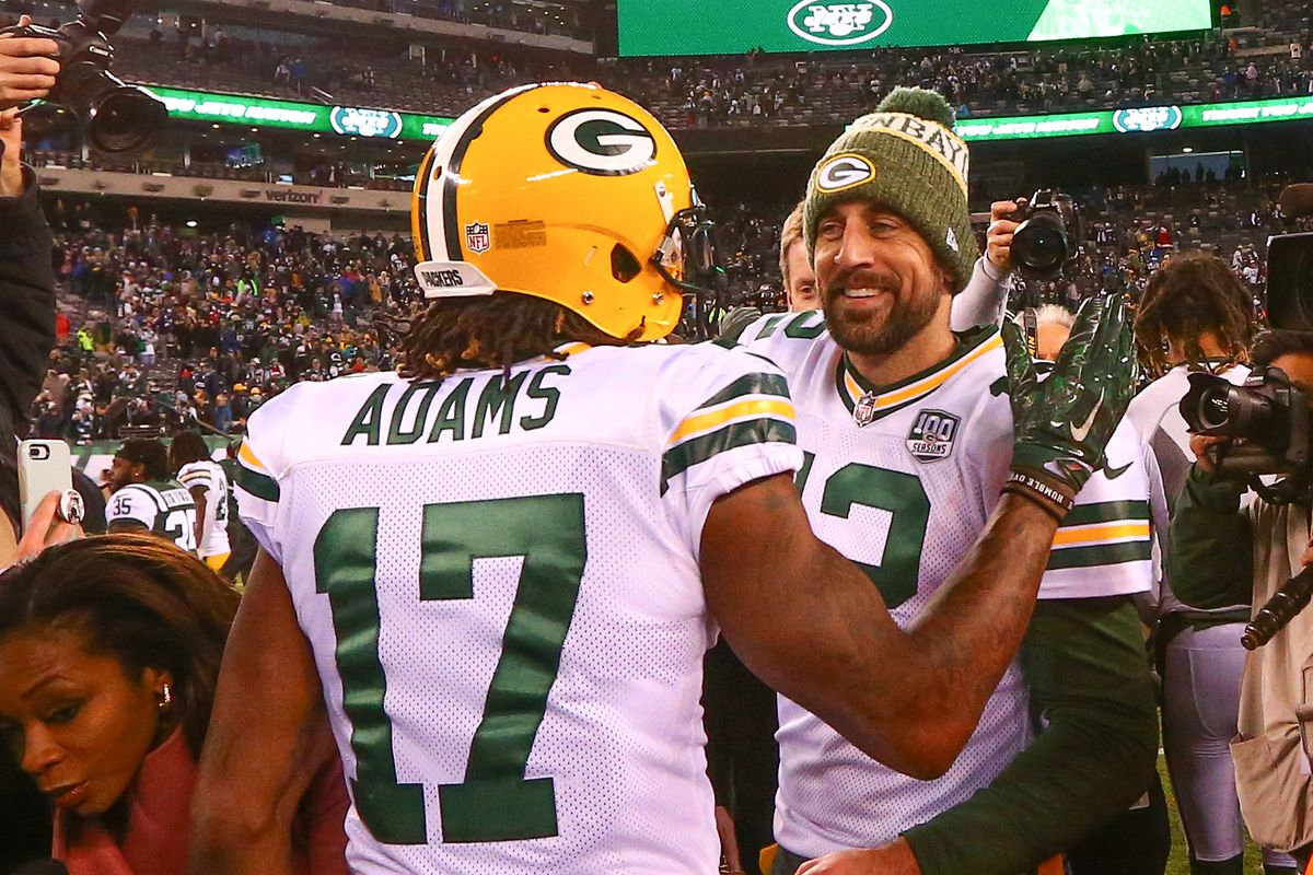 Green Bay Packers quarterback Aaron Rodgers and Green Bay Packers wide receiver Davante Adams slap hands and hug after the National Football League game between the New York Jets and the Green Bay Packers on December 23, 2018 at MetLife Stadium in East Ru