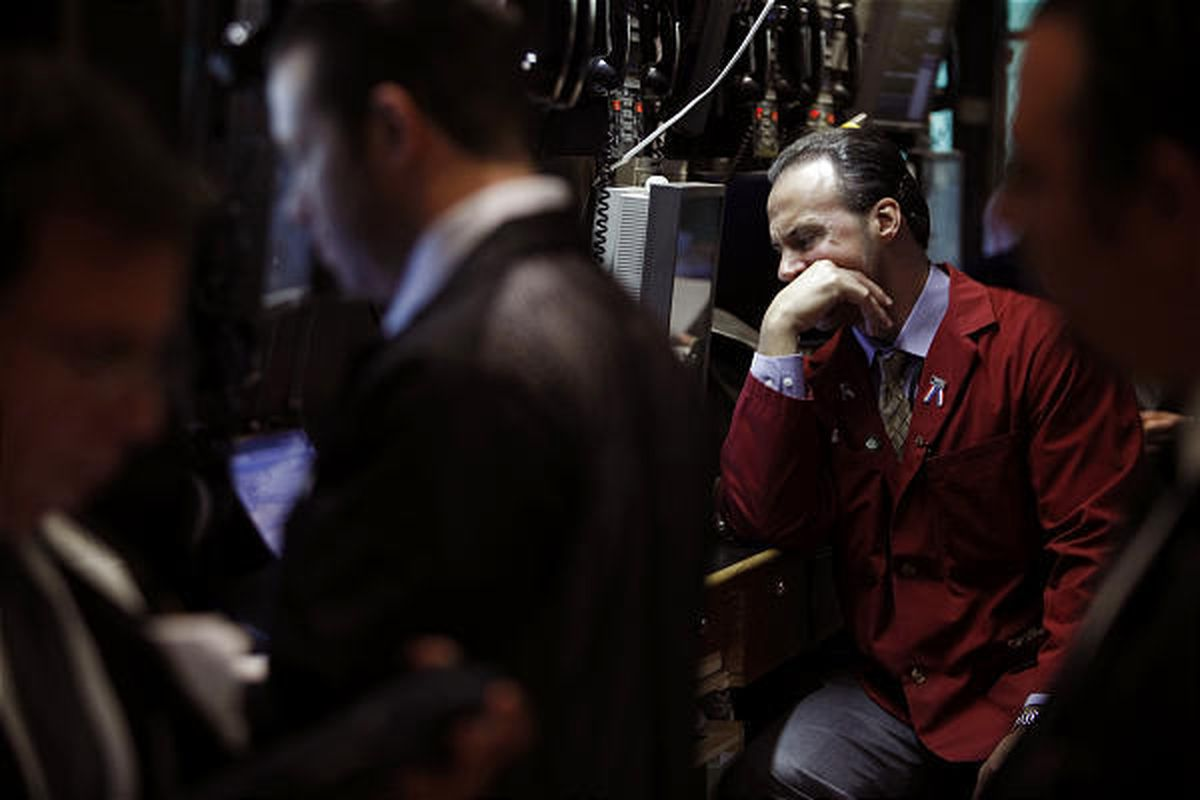 Traders work on the floor at the New York Stock Exchange in New York Tuesday.