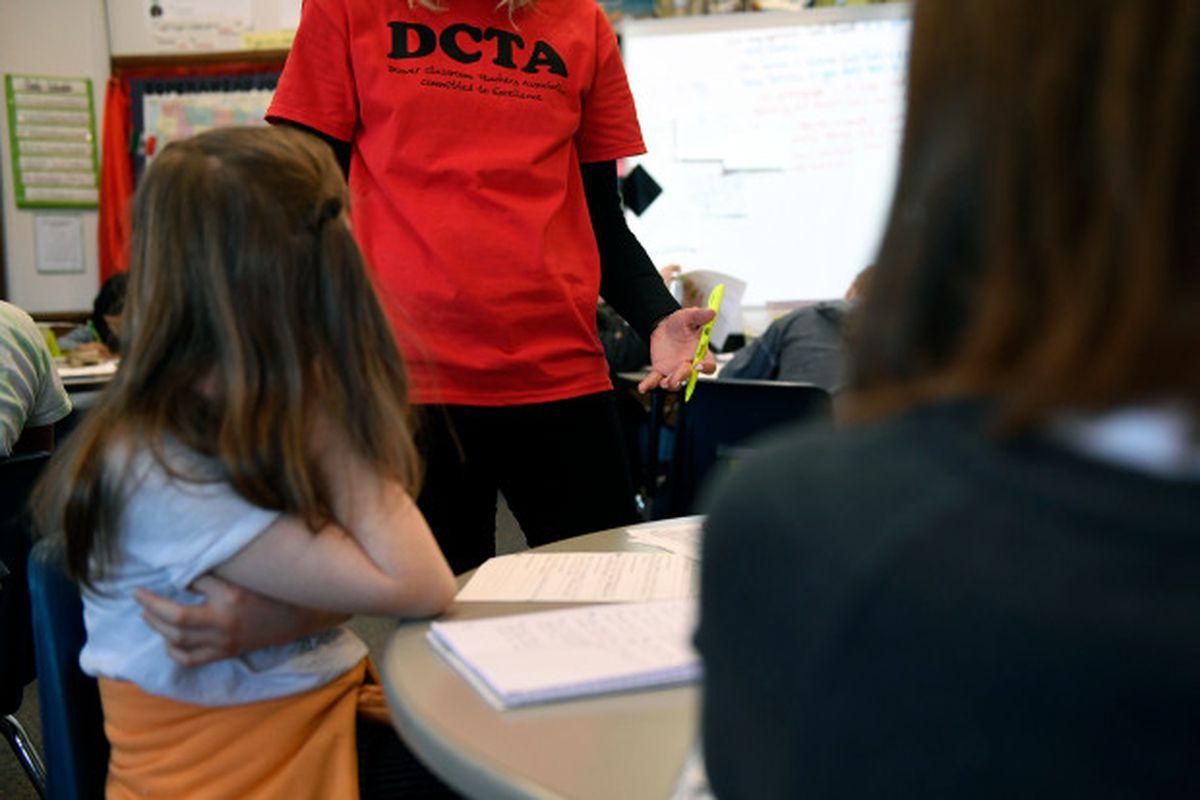 A teacher wears a Denver Classroom Teachers Association T-shirt in class during the strike.