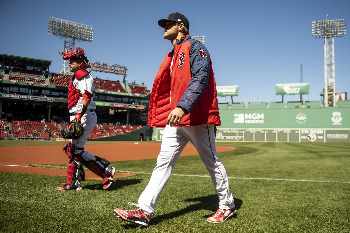 Tanner Houck #89 and Kevin Plawecki #25 of the Boston Red Sox walk toward the dugout before a game against the Baltimore Orioles on April 3, 2021 at Fenway Park in Boston, Massachusetts.