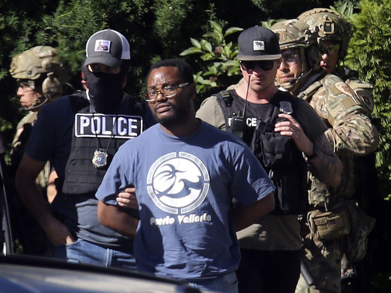 Salt Lake police take Ayoola Adisa Ajayi into custody in Salt Lake City on Friday, June 28, 2019. Ajayi, 31, is accused of murdering University of Utah student Mackenzie Lueck.