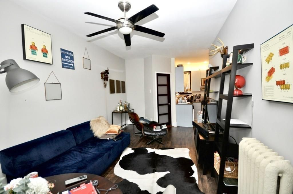 Another shot of that living room leading toward the kitchen. The living room is small.