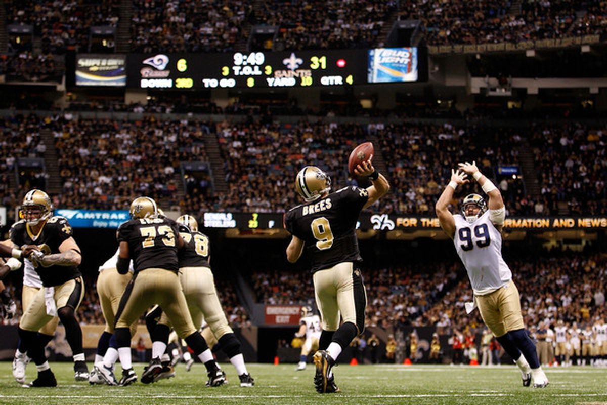Drew Brees #9 of the New Orleans Saints throws a pass during the game against the St. Louis Rams at the Louisiana Superdome on December 12 2010 in New Orleans Louisiana. The Saints defeated the Rams 31-13.  (Photo by Chris Graythen/Getty Images)