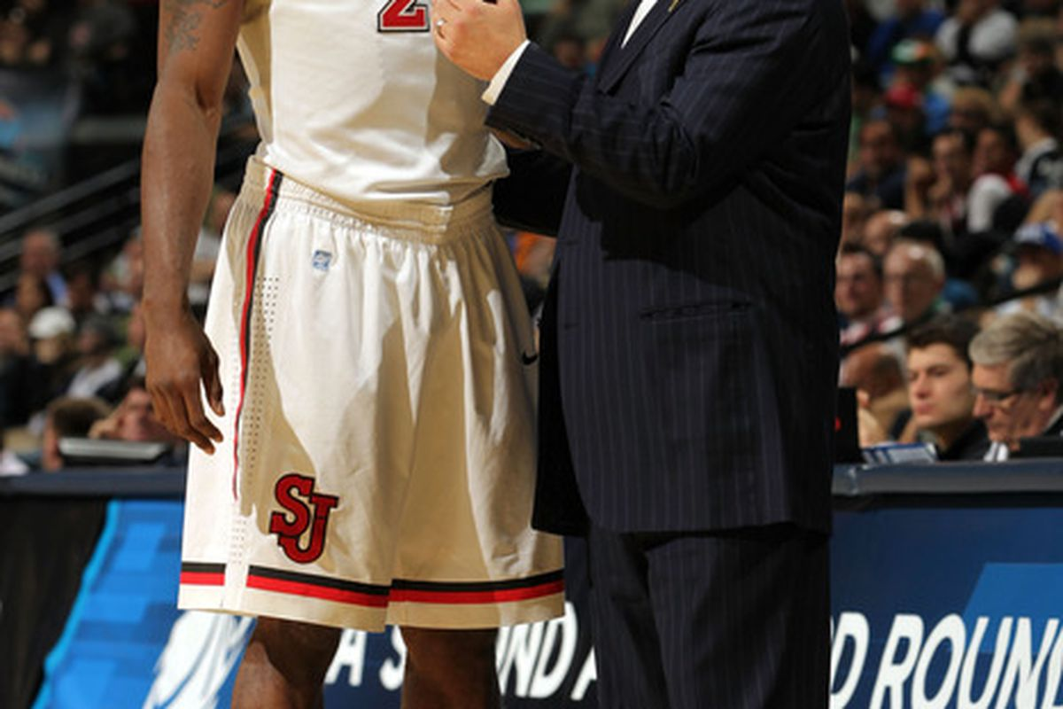 Justin Burrell, listening to instructions from head coach Steve Lavin.