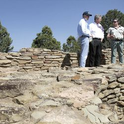 Forest Service archaeologist Wendy Sutton, right, explains kiva features to Interior secretary Ken Salazar and Agriculture secretary Tom Vilsack at Chimney Rock monument.  Forest Service archaeologist Wendy Sutton, right, explains kiva features to Interior secretary Ken Salazar and Agriculture secretary Tom Vilsack at Chimney Rock monument.