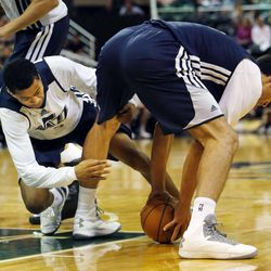 Trey Burke and Enes Kanter wrestle for the ball during Utah Jazz scrimmage in Salt Lake City, Saturday, Oct. 5, 2013.