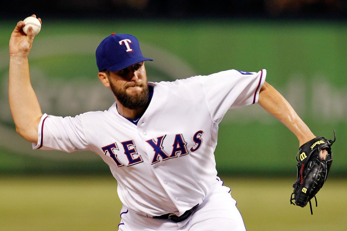 ARLINGTON, TX - AUGUST 24:  Darren O'Day #56 of the Texas Rangers pitches against the Boston Red Sox at Rangers Ballpark in Arlington on August 24, 2011 in Arlington, Texas. The Red Sox beat the Rangers 13-2. (Photo by Tom Pennington/Getty Images)