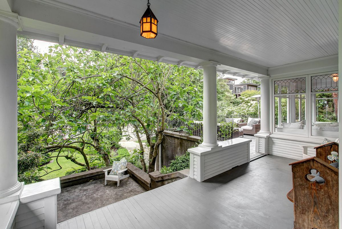 A back porch with smaller decks leading down to a lower backyard