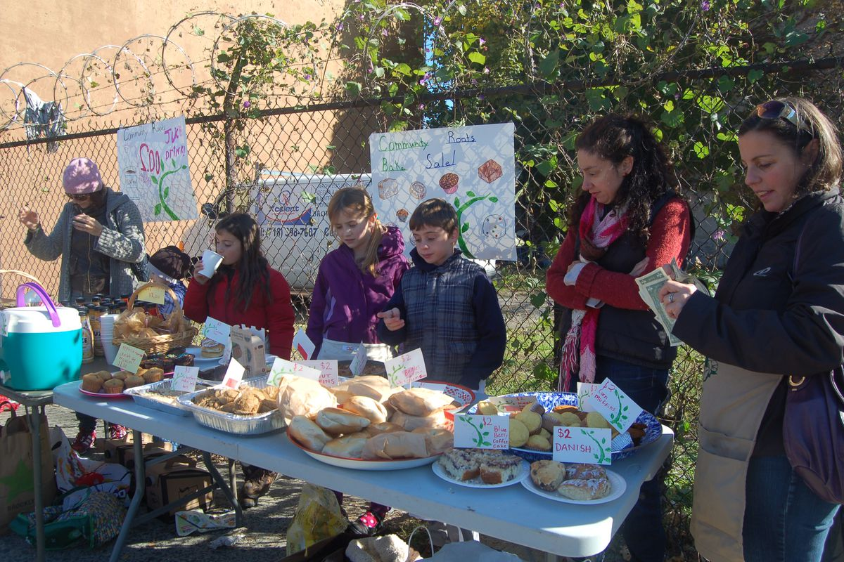 Families from Community Roots Charter School in Brooklyn hold a bake sale.