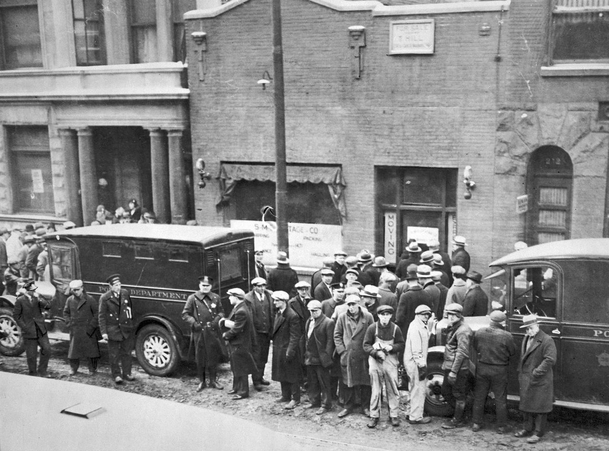 Police and residents gather in front of the S.M.C. Cartage Co. garage on North Clark Street after the St. Valentine's Day massacre.   Chicago History Museum/Distributed by AP