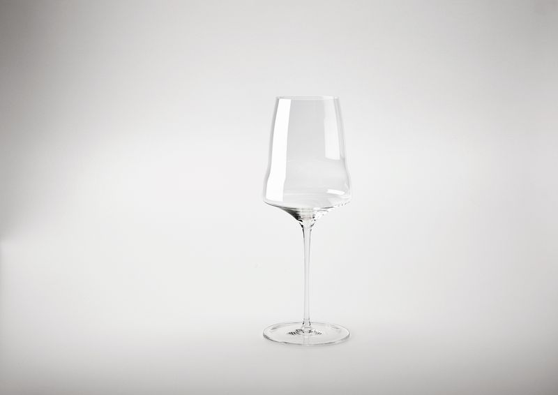A single wine glass with a curved bowl