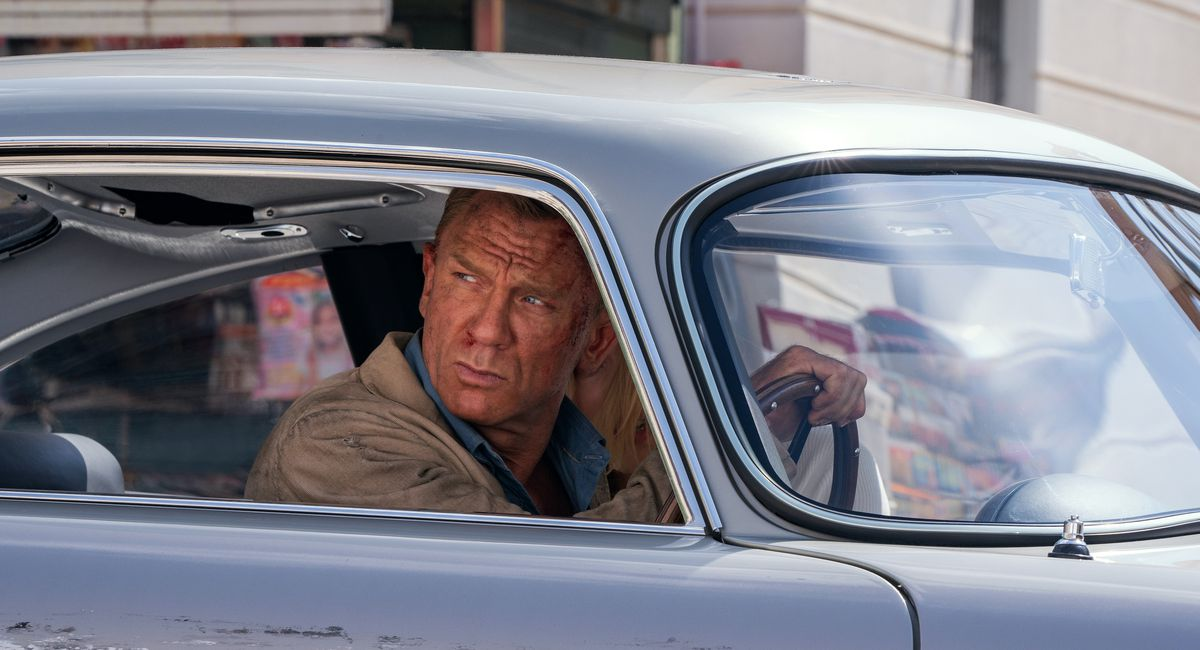 Daniel Craig looks beat to hell in a beat-to-hell care as James Bond in No Time To Die